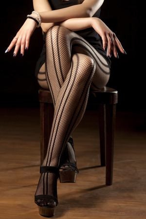 feminine crossed legs in fishnet stockings