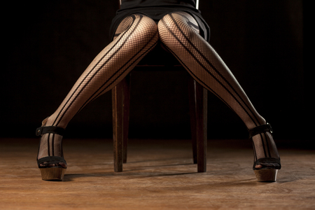 legs stockings: feminine legs in fishnet stockings