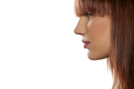 profile of a young woman with bangs Stock Photo