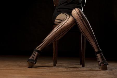 feminine legs in fishnet stockings