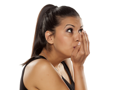 beautiful young woman checking her breath
