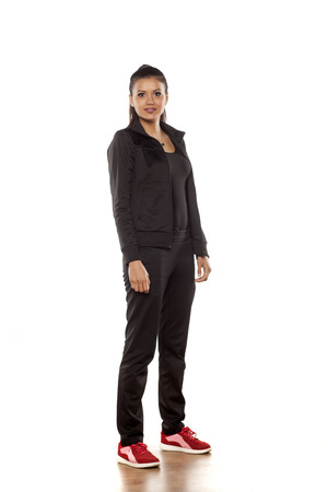 women sport: young pretty woman in tracksuits posing in the studio