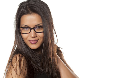 mujeres morenas: beautiful young woman with glasses Foto de archivo