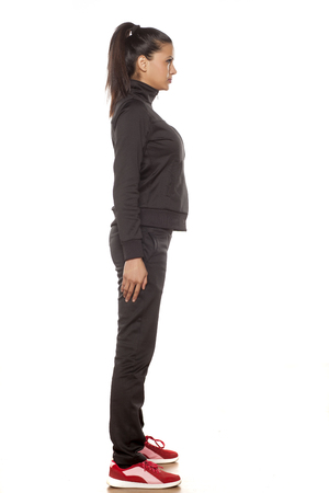 cuban women: Side view of a young pretty woman in tracksuits posing in the studio