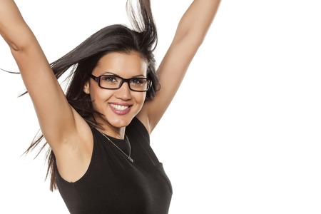 cuban women: happy beautiful young woman with glasses making winning gesture