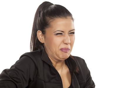 disgusted: beautiful young woman is disgusted by something Stock Photo
