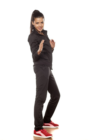 cuban women: young pretty woman in tracksuits posing in the studio
