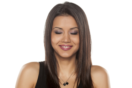cuban: Smiling young dark-skinned pretty woman with closed eyes Stock Photo