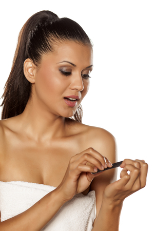 woman filing her nails Stock Photo