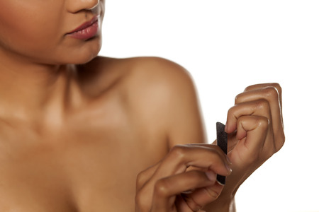 nails: woman filing her nails Stock Photo
