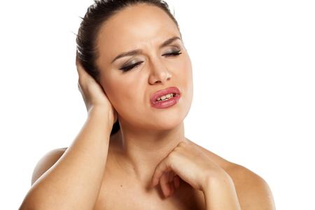 dolor de oido: Young beautiful woman has pain in the ear Foto de archivo