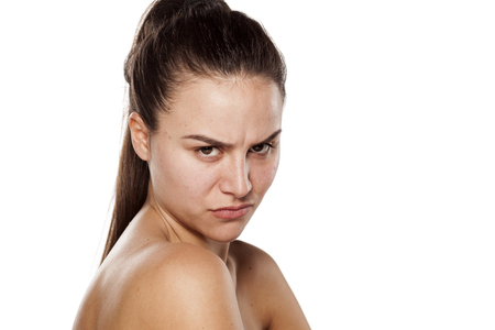 Angry young woman without make-up Stock Photo