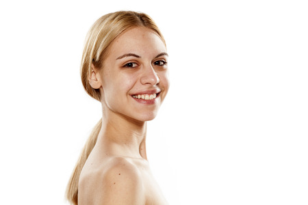 smiling young woman without makeup on a white background
