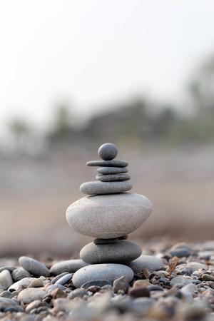 pile of balanced round stones on the beach Stock Photo