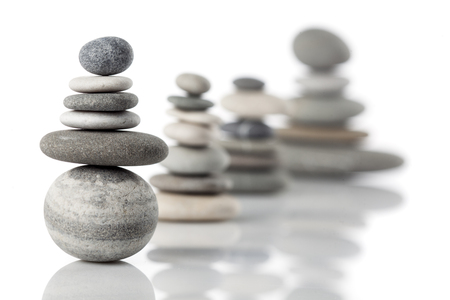 Group of balanced piles of different river stones Standard-Bild