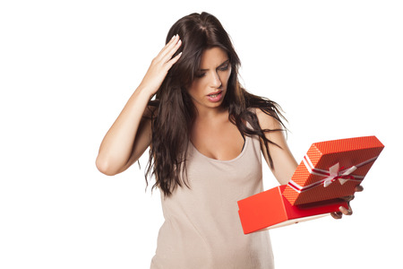 pretty girl is not happy with her gift Stock Photo