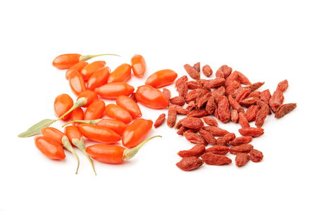 lycium: pile of dry and fresh goji berries on a white background