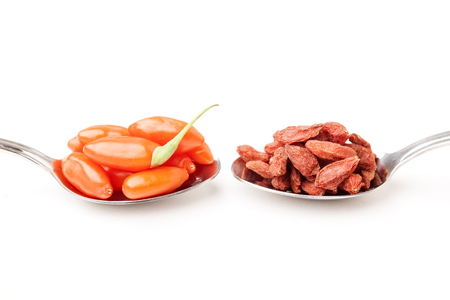 chinese wolfberry: pile of dry and fresh goji berry on a white background