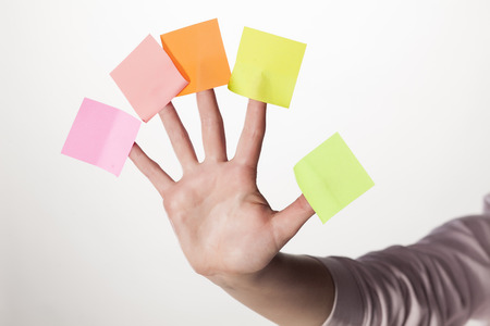Female hand with five paper stickers on her fingers