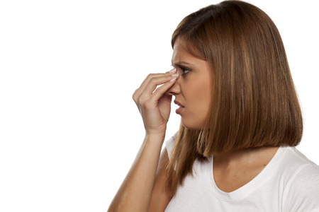 young beautiful woman has pain in the sinuses Stock Photo