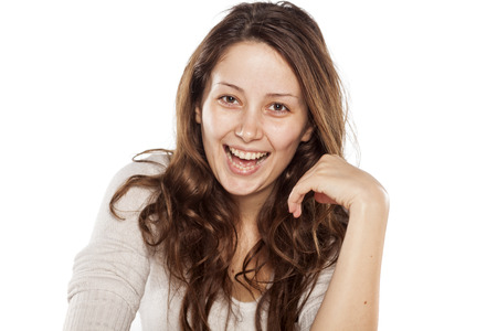 no teeth smile: Happy young woman without makeup and long brown hair on a white background