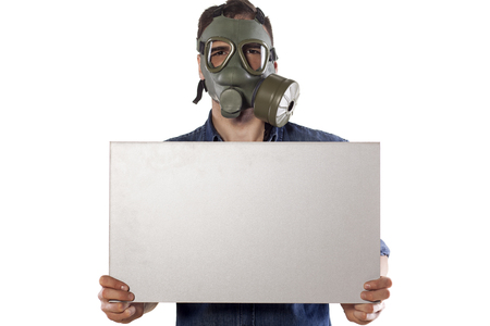 gasmask: man with a gas mask holding a blank board