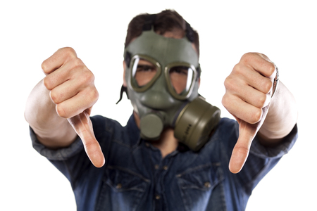 gasmask: man with a gas mask showing thumbs down Stock Photo