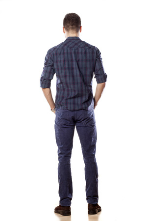 Rear view of a young man in blue jeans Stock Photo