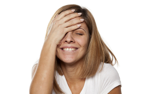 adult oops: smiling young woman forgot something