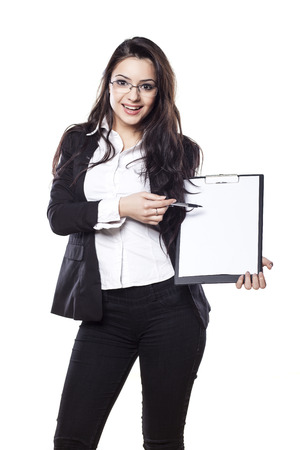 Beautiful smiling young business woman posing with a clipboard Stock Photo