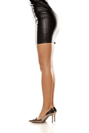 leather skirt: short black leather skirt, legs, and high heels