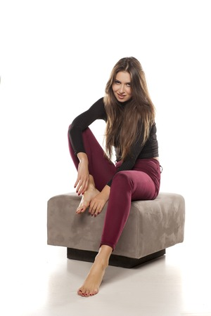 the footstool: beautiful young woman posing on a footstool