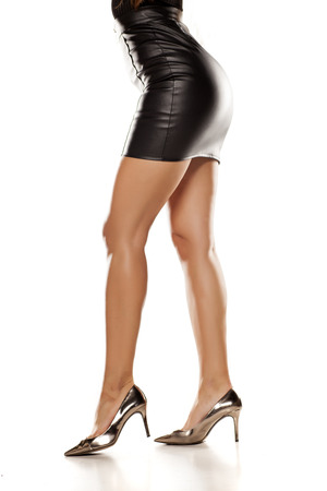 short black leather skirt, legs, and high heels