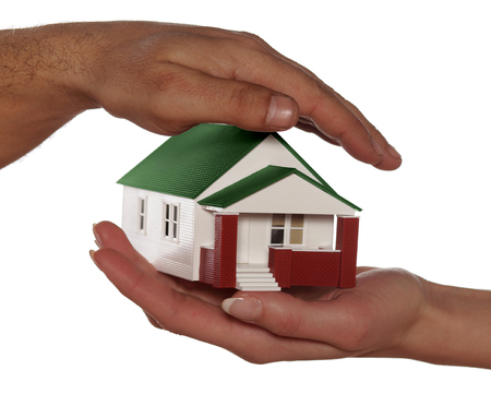 ownerships: Miniature model house in human hands Stock Photo