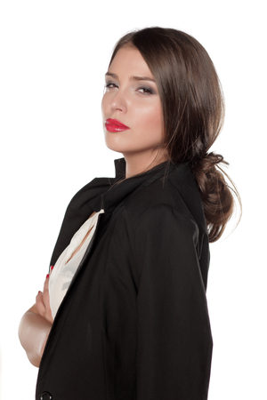 skeptical: suspicious business woman on a white background
