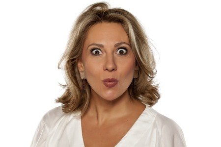 middle-aged pretty woman with wide open eyes Stock Photo