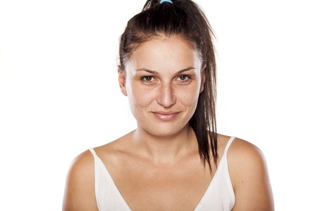 fake smile: Natural young woman with a fake smile
