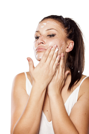 young women applied cream for removing makeup on her face Stock Photo