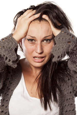 Depressive messy and crying woman on white background