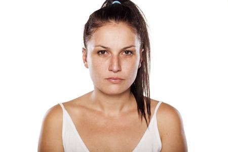 Serious natural young woman posing without makeup Stock Photo