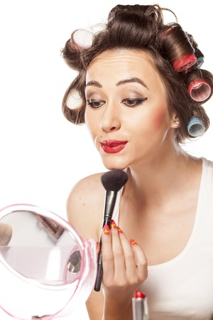 happy woman with curlers and bad makeup applied blush Stock Photo