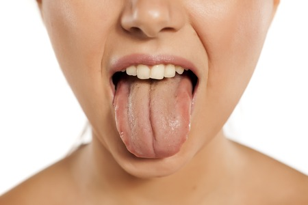 young woman stick out her tongue