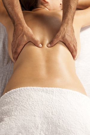 remedial: young woman enjoys back massage