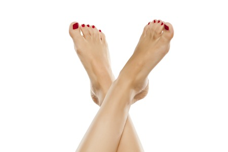groomed: beautiful groomed female foot with red nail polish Stock Photo