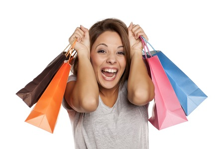happy woman posing with shopping bags on a white background