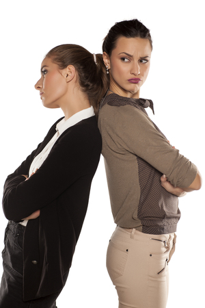 each: Two young women angry at each other