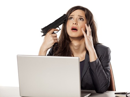 weeping young businesswoman wants to kill herself with a gun Stock Photo