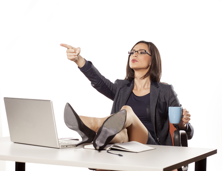 Computer instruction: angry businesswoman with legs on the table command to others