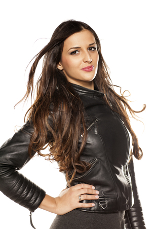 pretty girl in a leather jacket on white background