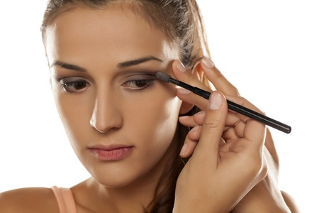 woman shadow: young woman applied eye shadow with applicator Stock Photo